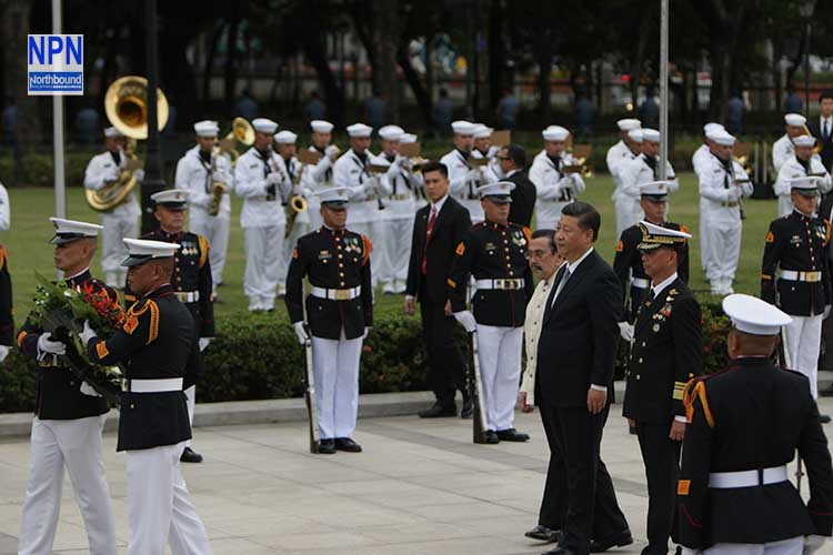 Xi pays his respect at Rizal monument