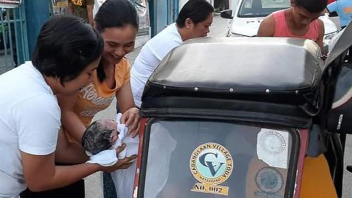 Pangasinan cops help woman give birth inside tricycle