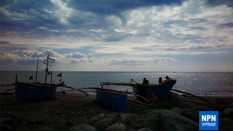 A fisherman tends his boat because he can not sail due to Community Quarantine at Barangay Baluarte in Agoo, La Union on Tuesday (May 5,2020).