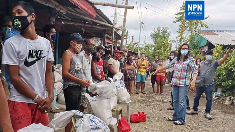 Mayor Menchie de Guzman supervises the distributions of relief goods to the residents of Barangay Pagdalagan Sur while implementing proper social distancing in Bauang, La Union